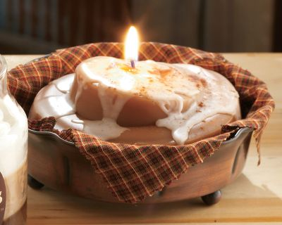 Get the fresh-from-the-oven aroma of cinnamon buns without baking. Each hand-rolled wax candle looks like a freshly-glazed bun and includes an antique-looking metal holder. Burn time: 50 hrs. Dimensions: 2H x 4 diameter. Weight: 12 oz. - $14.99
