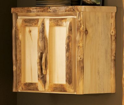 Entertainment Bring the ambience of a mountain lodge into your home dcor with this beautiful wall cabinet. Its handcrafted from 100% pure Rocky Mountain aspen and like trees, no two feature the same grains in the wood. Hand-sanding gives it a polished look. Kiln dried and finished with a protective layer of beeswax, linseed oil and other organic materials. Its sealed with polyacrylic for moisture protection. Adjustable shelf offers more storage options. Made in USA. 26H x 31W x 14D. Note: Dimensions are approximate due to slight inherent variations in lumber. - $599.99