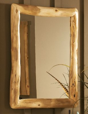 Entertainment Bring the ambience of a mountain lodge into your home dcor with this beautiful mirror. Its handcrafted from 100% pure Rocky Mountain aspen and like trees, no two feature the same grains in the wood. Hand-sanding gives it a polished look. Kiln dried and finished with a protective layer of beeswax, linseed oil and other organic materials. Its sealed with polyacrylic for moisture protection. Features well-crafted mitered corners to secure the 1/4-thick mirror. Made in USA. 30H x 25W x 3D. Note: Dimensions are approximate due to slight inherent variations in lumber. - $399.99