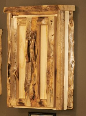 Entertainment Bring the ambience of a mountain lodge into your home dcor with this beautiful medicine cabinet. Its handcrafted from 100% pure Rocky Mountain aspen and like trees, no two feature the same grains in the wood. Hand-sanding gives it a polished look. Kiln dried and finished with a protective layer of beeswax, linseed oil and other organic materials. It is sealed with polyacrylic for moisture protection. Two adjustable shelves offer versatile storage options. Made in USA. 32H x 24W x 7D. Note: Dimensions are approximate due to slight inherent variations in lumber. - $499.99