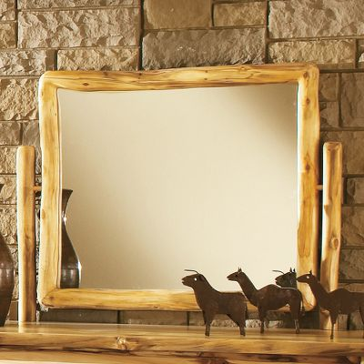 Entertainment Complete your Aspen Log bedroom set with this handcrafted dresser mirror and frame. Hand-sanded, kiln-dried and finished with a protective layer of beeswax, linseed oil and other organic materials, the frame matches the rest the bedroom collection. Assembly is required. Made in USA. * = Quickship item. (Quick Ship items will be delivered within 3-5 weeks upon receipt of order.) Note:Dimensions are approximate due to slight inherent variations in lumber. - $399.99