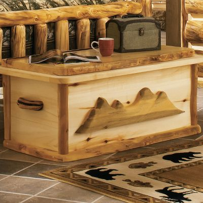 Entertainment The unique character and rich, natural hues of 100% pure Rocky Mountain Aspen gives this chest a look thats as rustic as it is elegant. Each handcrafted piece in this spectacular set bears natures own markings, so no two are exactly alike. It is hand-sanded, kiln-dried and finished with a protective layer of beeswax, linseed oil and other organic materials. Surfaces that are likely to get wet are also finished with an extra layer of waterproof polyurethane. Log chest has a removable cedar lining. Made in USA. Dimensions: 48 x 24 x 25. * = Quickship item. (Quick Ship items will be delivered within 3-5 weeks upon receipt of order.) Note:Dimensions are approximate due to slight inherent variations in lumber. Color: Natural. - $1,399.99