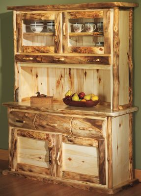 Entertainment Our log bedroom furniture has proven to be so popular, we are now offering a new line of matching dining-room accessories with the same natural beauty and rustic appeal. The two-piece buffet and hutch pack a lot into a moderate sized space (60W x 21D x 78H). Comes shipped in two pieces, no assembly required. Hutch has adjustable shelf on each side behind aspen/glass doors with three decorative accessory drawers. Buffet has a large shelf behind cabinet doors and three drawers for silverware or linens. Solid aspen skirting on base front and sides of buffet. Doors on the buffet and hutchtop feature soft-close hinges, for a gentle, secure, door closure every time. Available in rounded fronts for a rustic look. Buffet top is hand-finished with three coats of polyurethane for durability while the front and sides are hand-rubbed with linseed oil and beeswax to highlight the natural beauty of the pure Rocky Mountain aspen. Made in USA. 60 x 21 x 78. Note: Dimensions are approximate due to slight inherent variations in lumber. Color: Natural. - $2,999.99