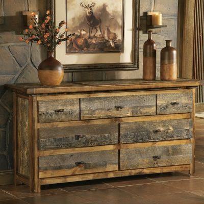 Entertainment Welcome the courageous spirit of the west into your home with furniture that is faithful to its pioneering heritage. Every piece in this one-of-a-kind collection has an identity all its own. Master craftsmen in Laramie, Wyo. combined rare, never-the-same barnwood with regionally harvested woods to create this uncommonly graceful collection. Besides offering a unique piece of history from the American west, reclaimed wood boasts a naturally weathered appearance and authentic patina that cant be found elsewhere. The widely varying knot patterns, grain designs and colors from rich, weathered grays to shades of orange and red give each piece its own personality. As a Founding Member of the Sustainable Furniture Council, Mountain Woods Furniture is committed to using mostly reclaimed or dead-standing wood, and where necessary, supplementing those wood sources with sustainably sourced, locally harvested aspen trees. The company uses wood scraps to efficiently heat their facility and utilize low-VOC stain and water-based finishes during construction to minimize indoor air pollution. The pieces in the Wyoming Bedroom Collection surpass Built Green standards. This dresser has durable roller glides and dovetail drawers. Add a final touch to the set with your choice of antique bronze or faux-antler drawer pulls. 7-drawer dresser shown. Made in USA. Dimensions: 32H x 72W x 21D. Handle choices: Antique bronze, Faux-antler. Note: Dimensions are approximate due to slight inherent variations in lumber. Color: Barnwood. Type: Dressers. - $1,999.99