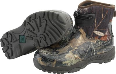 Hunting Built like hikers with the eas-t-clean, waterproof performance of rubber boots. Lightweight and flexible 5mm CR fle-foam booties with fou-wa-stretch nylon seal out water and mud. Ful-perimeter Flex outsoles promote comfortable walking and provide maximum protection to toe, arch and heel areas. Ankl-fit lasts and cinch laces with cord locks ensure a snug fit. Breathable Airmesh linings wick away perspiration. Removable 6mm Nitracel EVA sock liners add support and slippe-soft molded comfort in the footbeds. Hand-free easy on and off. Comfort range of su-freezing conditions to 85F. Imported.Mens sizes: -15.Camo pattern: Mossy Oak New Brea-Up. - $129.99