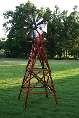 Camp and Hike Add an iconic rural accent to your yard in the form of a classic windmill. The tower is crafted of high-quality wood thats pre-stained and pre-drilled for easy assembly. The head is galvanized steel that will last for years. Red blade tips give it a vintage look. Made in USA. Assembled height: 9 ft. 4 in. Base diameter: 3 ft. 6 in. Head diameter: 30. Color: Red. - $369.99