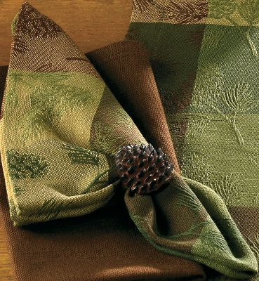 "Entertainment Few images bring forth thoughts of the outdoors like those of pine boughs and pine cones. Their subtle presence in the squares of shaded browns and greens throughout this collection will have guests thinking they sense the pleasing aroma of pine mingled with the meal you re serving. Crafted of easy-to-clean 100% cotton. Imported.Available:Placemats. Per 4. Dimensions: 13"" x 19""Table Runner. Per 1. Dimensions: 13"" x 36"" 18"" Square Napkins. Per 4.Dish Towel/Dish Cloth/Pot holder set. Includes two of each. - $12.88"