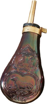 Entertainment This all brass antique looking powder flask is the perfect companion to your Remington .44 caliber revolver. The easy to use spout holds 24 grains of black powder. The flask can hold approximately four ounces of black powder and is ornately decorated with a resting dog and two birds on each side. Color: Black. - $34.99