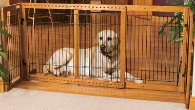 Hunting Your pet may be your best friend, but there are times when it's best to keep your pet confined to a certain section of the house. Not every visitor may be as fond of your pet as it is of making new friends. Sometimes large, friendly dogs can overwhelm young guests with a bit too much affection. And when housebreaking or litter box training is underway, you'll be grateful to own one of these innovative portable barriers. Each Pet Gate is self-supporting, requires no installation, and can be set up just about anywhere in less than a minute. The side supports fold flat against the gate for convenient storage and easy transport. Because these gates have rubber feet, you needn't be concerned about scuffing or scratching your floor. Pet Gates have an attractive hardwood finish that won't detract from your home's de They adjust in width so that you can position them in doorways, hallways, at the top or bottom of a stairway, or even place them against a wall to create a temporary kennel inside while you answer the door. And because these gates are so easy to transport, they're perfect when you bring your pet along on a trip and stay in motels or the home of a friend or relative. Pet Gates can also help protect your pet by keeping it out of the way and out of trouble when you're painting, remodeling or working with materials that could be harmful if ingested. The HL model creates a 7.5 taller barrier to keep larger dogs or jumping pets contained. Dimensions: 27.6 H x 39.4 to 70.9 W x 23.6 D. - $157.49