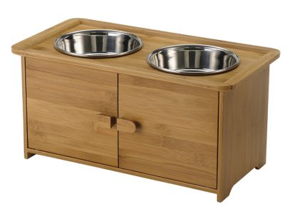 Hunting An award-winning feeder and storage cabinet in one. Ergonomic, elevated design minimizes discomfort for senior pets with stiff muscles and joints. Eco-friendly bamboo cabinet holds two stainless steel bowls (included) and boasts convenient storage underneath for food and treats. Rubber feet protect your floor from scratches and prevent sliding. No assembly required. Recommended for medium- to large-size dogs. Clean wood with soft dry cloth and wood polish/cleaner. Includes instruction manual. Dimensions: 8.9H x 18.1W x 9.5D. Color: Stainless Steel. - $79.99