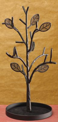 Entertainment Drape and organize your necklaces, bracelets and more on the elegantly-designed leaves and branches of this jewelry tree. Each leaf has holes for earrings to keep pairs together. Made of metal with a velvet-lined base tray to hold pendants, rings and other keepsakes.Dimensions: 14H x 6W. - $29.99