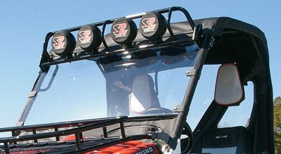 "Motorsports Give your UTV a custom look, while protecting your expensive lights and windshield from overhead damage. Hinged, tiltable mounting system allows the light bar to be quickly rotated forward for low-clearance situations. Rhino and RZR Light Bar have four light tabs and includes Seizmik driving lights (Ranger has five). Steel housing with a durable powder-coated black finish. Long-range beam uses H3 55-watt halogen bulbs. 6-1/2"" diameter. RZR Light Bar's integrated rack provides overhead lighting and additional storage. Compatible with or without OEM plastic roof. Includes four lights with wire harness. - $349.99"