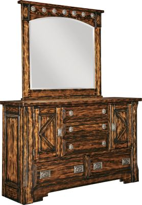 Entertainment The Mountain Mesa collection is a fresh take on a classic Western style. Each piece is constructed of solid pine and hand-carved throughout, then finished using a special veneer process to reveal an aged, rustic look. Hand-polished cast-aluminum tack accented by scalloped carving adds to the Western flair of this beveled mirrors frame. Coordinating bedroom furniture is available in this collection.Dimensions: 44H x 49W x 3D. - $519.99