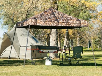 "Camp and Hike For shade and protection from precipitation at a party, campground, hunting camp, picnic area or park, this sturdy and easy-to-set-up portable shelter has got you covered. The top is durable heavy-duty polyester treated inside and outside with anti-aging, anti-fungal and fade-resistant coatings to maximize the longevity of the canopy. The fabric is lined on the inside with water-resistant polyurethane that's double stitched and seam-sealed with waterproof tape so you won't have to worry about drips getting through. The frame is strong, 1-1/2"" welded tubular steel with synthetic joint components engineered for lasting service. Its steel is also bonded with DuPont thermoset baked-on powder coating to prevent rust, corrosion, chipping and peeling. Each leg has four height-adjustment point options. This canopy comes with a full valance fitted cover, temporary spike anchors for securing it to the ground, and a wheeled storage bag that makes it easy to get the canopy to and from your setup location. The 10-ft. x 10-ft. canopy is the Next G-1 camouflage pattern to display your love of the outdoors and to better blend in with natural surroundings. Imported. Weight: 42 lbs. Camo pattern: Next Camo G-1. - $74.88"