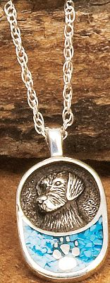 "Entertainment The use of turquoise in jewelry dates back more than 7,000 years to ancient Europe. Later, it was sought by early American Indians as a good luck charm. Now, enjoy a good luck charm of your own with its own classic style in turquoise chip and the ornate image of America's most beloved breed of dog. 18"" sterling silver light rope chain. - $59.99"