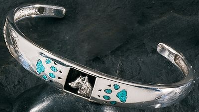 Entertainment This lovely silver bracelet is adorned with turquoise wolf paw prints and displays the distinctive profile of a wolf in the center. One size fits most. Size: One Size. Color: Turquoise. Gender: Female. Age Group: Adult. Type: Bracelets. - $191.99