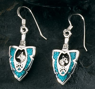 Entertainment Beautifully crafted using sterling silver and turquoise, these dangle earrings are inlaid with images of a wolfs head and paw print. Theyre an eye-catching way to communicate your love of the outdoors. Color: Turquoise. Gender: Female. Age Group: Adult. Type: Earrings. - $55.99