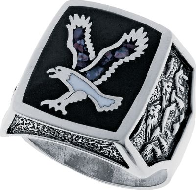 Entertainment This sterling-silver mens ring features a majestic flying eagle inlaid with a white magnesite and brown hematite mixture. Black resin is inlaid around the eagle, giving it a unique frame that highlights the sterling silver outline of the eagle. A mountain scene embellishes the sides of the band. Made in USA. Setting dimensions: 5/8L x 3/4W. Whole sizes: 7-15. - $199.99