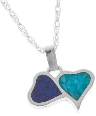 Entertainment Two fun and playful hearts hug in this sterling silver pendant from Silver Legends. One heart is inlaid with turquoise, which is believed to protect against evil and bring good luck. The second heart is inlaid with lapis chips, a navy blue man-made material. Made in USA. Pendant dimensions: 7/16L x 5/8W. Chain length: 18. Color: Silver. Gender: Female. Age Group: Adult. - $49.99