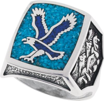 Entertainment This sterling silver mens ring features a majestic flying eagle inlaid with lapis chips, a navy blue man-made material. Turquoise is believed to protect against evil and bring good fortune, and the main setting is inlaid around the eagle with turquoise chips. A mountain scene embellishes the sides of the band. Made in USA.Setting dimensions: 5/8 L x 3/4W.Whole sizes: 7-15. - $199.99