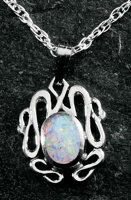 Entertainment Notice the subtle glances of admiration while wearing this classy opal pendant. The dazzling white opal is man-made for consistent color and enhanced durability. Sterling silver chain. Made in USA.Dimensions: 9/16H x 1/2W.Chain length: 18. - $59.99