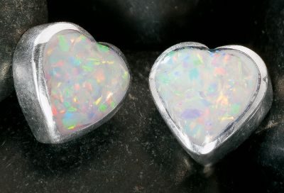 Entertainment These tiny heart earrings are inlaid with man-made white opal, which is more durable and consistent in color than natural opal. Sterling-silver posts and hypoallergenic backs. Made in USA. Dimensions: 1/4L x 1/4W. Color: Silver. Gender: Female. Age Group: Adult. Type: Earrings. - $31.99