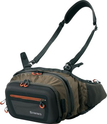 Flyfishing Go light and carry your tackle in a lightweight pack with a large capacity and easy access. Integrates with the Day Pack using the magnetic Catch Release modular system. Lightweight, practically indestructible 315 HTnylon Auto Airbag fabric resists tears and abrasion. Back panel and hip belt are even more breathable and anatomic than previous versions. Molded front pocket with improved pockets and functionality. Sleek design lessens the chance of line snagging. Imported.Capacity: 440-cu.-in.Dimensions: 11H x 8W x 5D.Approximate weight: 9.2 oz.Color: Dark Elkhorn. - $64.88