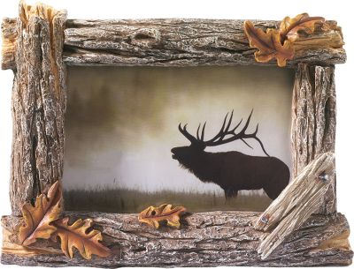 Highlight your favorite family memory or outdoor adventure in this rustic, weathered fence-post frame. Long-lasting poly-resin construction is hand-painted with a glass insert that protects your cherished 4 x 6 photos from dust and aging. Easel back stands horizontally. Frame size: 8W x 6H. Photo size: 4 x 6. - $14.88