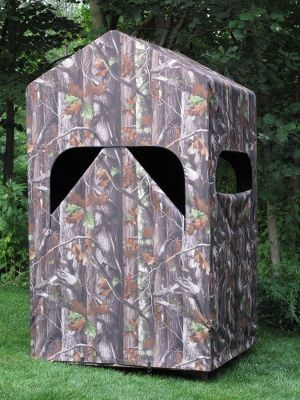 Hunting This tall, lightweight blind has plenty of room to stand up and move around, unlike many traditional ground blinds. The large interior provides ample room for you and all your gear, while keeping you protected from the elements. Rugged, coated 600-denier polyester fabric is water-repellent and stands up to seasons of abuse. A strong, light aluminum frame snaps together in seconds, making setup and takedown a breeze. Included carry bag for easy transportation in and out of the field. Optional window packages increase airflow and visibility, and keep bugs out. Installs on any 4L x 4W platform (not included). Imported. Dimensions: 4L x 4W x 66H. Weight: 35 lbs. Camo pattern: Next Camo G1. Color: Camo. - $299.99