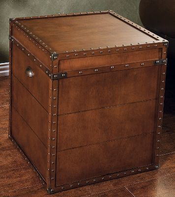 Entertainment Add a functional, vintage-style accent to your home that doubles as a unique storage solution. With a replicated antique walnut veneer, the Steamer Trunk End Table provides ample storage to help clear clutter. Crafted of medium-density fiberboard with antique brass hardware. Dimensions: 23.5H x 20W x 20D. Color: Walnut. - $169.99