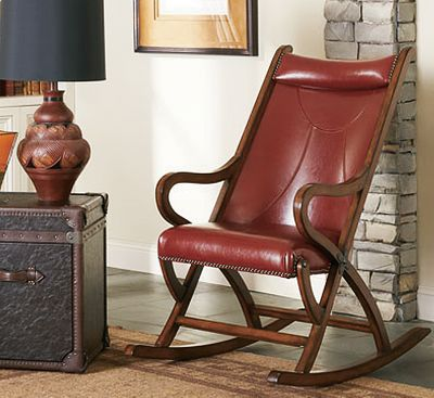Entertainment Classic hardwood rockers with high-quality, hand-finished craftsmanship. The solid hardwood frame boasts a hand-rubbed satin finish accented with nailhead trim. The bicast leather upholstery has a beautiful, even sheen thats easy to maintain and clean. Imported.Dimensions: 26'L x 31W x 44H.Finishes: Brown, Red. - $399.99