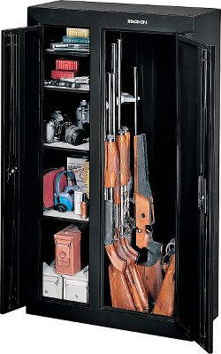 Hunting Your guns and valuables can be safely locked away in a Stack-On Gun Cabinet. A superior three-point, double-bitted, key-coded lock secures the unit. The door uses a full-length welded and staked piano hinge. Inside are foam-padded sides; bottom; and contoured, nonmarring barrel rests that include four standoffs for scoped guns. The exterior has a durable, baked-epoxy finish and reinforced steel doors. Fastening hardware and pre-drilled holes facilitate mounting. Dimensions: 32W x 13-1/2D x 55H. Weight: 135 lbs. Colors: Black, Green. Lift gate service (if desired) is not included in gun cabinet price. Color: Green. Type: Gun Cabinet. - $299.99