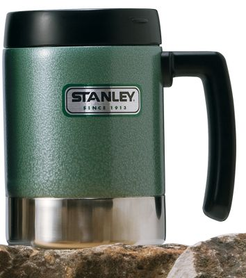 Stanley has been building durable, rugged products since 1913. Passed down from generation to generation, Stanley beverage containers are icons. With their classic hammertone green finish, they're built to last. This 18-oz. Classic Mug sports a splashproof flip lid, a stable, wide base and a large grip handle. Dishwasher safe. Color: Hammertone Green. - $18.88