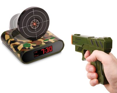 Finally, an alarm clock you can shoot. Normal mode requires one gunshot to enter snooze. Hard mode requires five gunshots to enter snooze. Doubles as a shooting game with two different game modes. Bright LCD screen. Record your favorite tunes as the sound of your alarm. Alarm clock requires four AA batteries and gun requires two AA batteries (batteries not included). Type: Clocks. - $19.88