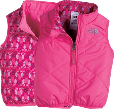 Keep your little one warm and dry with this insulated vest from The North Face. It sports a rugged 100% recycled polyester, water-resistant taffeta shell and 120 grams of Heatseeker Aero insulation. Reversible design features a playful print on one side and solid color on the other. Quilted body keeps insulation in place. Elastic arm openings seal out drafts. Embroidered logo on left chest. Imported. Sizes: 0-3 mo., 3-6 mo., 6-12 mo., 12-18 mo., 18-24 mo.Colors: Cha Cha Pink, Conifer Green. - $39.88