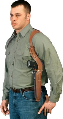Designed for a comfortable fit and easy drawing, this deluxe shoulder holster is made from rugged harness leather. The shoulder harness is constructed from heavyweight leather with elastic for a secure, personal fit. The extra snap belt loop can be used to secure the holster to a belt. - $89.99