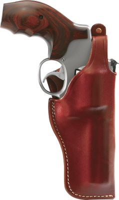 Entertainment A finely wrought closed-bottom holster with a close-to-the-body fit for maximum freedom of movement. Features a thumb break and a spring-stiffened safety strap for secure carrying. Fits belts up to 2.25 wide. Made in USA. Color: Brown. Color: Brown. Type: Traditional. - $44.99