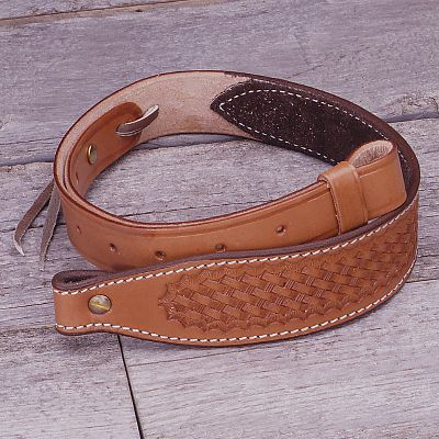 Carry your rifle securely. This top-grain, vegetable-tanned, steer hide leather sling has a suede lining to prevent your rifle from slipping and is tapered from 2 to 1 at the swivel. Waxed nylon thread and solid brass Chicago screws add durability. It adjusts from 28-1/2 to 35. Made in USA. - $34.99