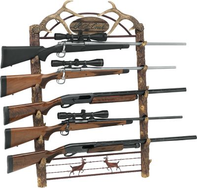 "Hunting Show off your firearm collection in rustic style with one of these outdoor-themed gun racks. Both versions sport realistic-looking faux tree trunks made of molded plastic resins on the sides. The top portion of the big-game model has a pair of antlers bracketing an outdoor scene and a wrought-iron finish on the fence-style bottom with two deer silhouettes. The waterfowl model displays a pair of ducks on the top and imagery of birds taking wing across the bottom. Both will complement the outdoor d cor of any home, cabin or lodge. Each rack holds five rifles or shotguns.Dimensions: 38.2""H x 23.6""W x 4.72""D.Available: Waterfowl, Big Game. - $132.99"