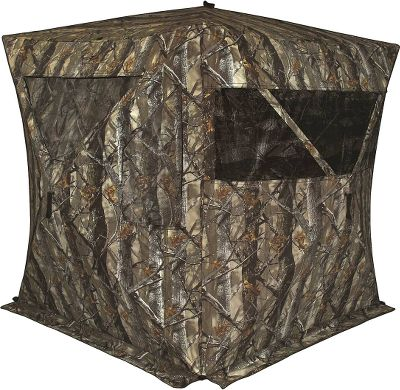 Hunting With a continuous, adjustable window on one side and eight total windows on the other three, no game will sneak up on you again. A blackout interior coating and shoot-through mesh on the windows keep you hidden at all times. Nearly silent hook-and-loop window closures ensure an open shot without being heard. Tough polyester/cotton shell keeps out wind and rain, and is reinforced around the corners and hubs. High-wind tie-downs and stakes secure the blind in adverse weather conditions. Entire blind packs down into an included backpack case for easy transportation in the field. Long-lasting, fade-resistant fabric. Imported.Dimensions: 65L x 65W x 70H.Weight: 19 lbs.Camo pattern: True Timber XD3. - $179.88