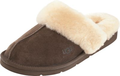 Entertainment The ultimate way to feel cozy and luxurious when lounging around or traveling. Genuine 17mm sheepskin liners and cuffs snuggle your feet and naturally wick away moisture, keeping your feet dry. Classic UGG suede uppers are paired with blown EVA soles with rubber pods for traction. Whipstitch detailing. Imported. Womens whole sizes: 6-10 medium width. Colors: Chestnut, Espresso. Size: 6. Color: Chestnut. Gender: Female. Age Group: Adult. Material: Suede. - $110.00