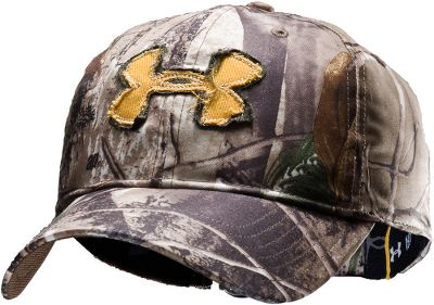 Hunting A frayed visor and distressed appliqu logo give it a battle-scarred look. Mositure-wicking Under Armour HeatGear sweatband offers all-day comfort. Quick-drying 100% polyester construction for lasting durability. One size fits most. Imported. Camo pattern/color: Realtree XTRA/Dynamite. Size: ONE SIZE FITS MOST. Color: Xtra/Dynamite. Gender: Male. Age Group: Adult. Material: Polyester. Type: Caps. - $18.88