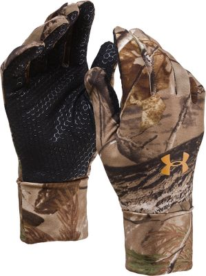 Hunting Under Armours Mens ColdGear Liner Gloves are the ultimate base layer for your hands. Polyester/elastane four-way-stretch fabric locks in warmth and dries quickly. Signature Moisture Transport System wicks moisture away from the skin. Silicone-plated palms for a secure grip. Extra-long cuffs stay tucked inside your sleeves. Imported. Sizes: S-XL. Color/camo patterns: Black/Black, Blaze Orange, Realtree XTRA, Realtree MAX-5, Mossy Oak Obsession, Mossy Oak Break-Up Country. Size: X-Large. Color: Black/Black. Gender: Male. Age Group: Adult. Pattern: Camo. Material: Polyester. Type: Gloves. - $24.99