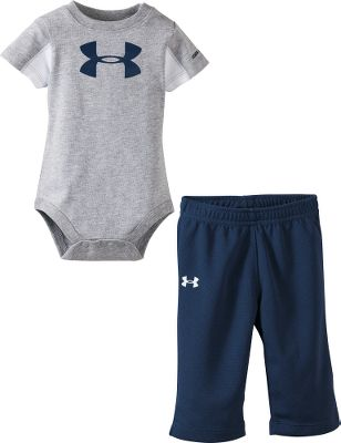 Sports Encourage athleticism from the very beginning! This comfy, short-sleeve snap shirt features football-jersey-style mesh side panels and comes with a complementary pair of pants. Both bear the Under Armour logo. 100% cotton; mesh is 100% polyester. Imported.Sizes: 0-3 mo., 3-6 mo., 6-9 mo.Color: True Grey Heather. - $24.99