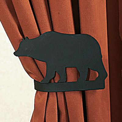 Hunting Give your window treatment an outdoors makeover with the Curtain Tieback Set. Made of durable wrought iron. Mounting hardware included. Per pair. Made in the USA. Available: Deer and Pines, Pine Cone, Moose, Deer, Pine Tree. Gender: Male. Age Group: Adult. Type: Curtain Rods & Hardware. - $24.99