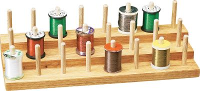 Flyfishing Beautiful, solid oak spool riser for keeps your fly-tying threads organized and readily available. Unit has three tiers that hold up to 24 spools. Color: Oak. Type: Vises. - $19.99