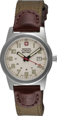 A classic-looking, military-style field watch in a feminine size. The brushed stainless steel case holds a clear crystal dial face with Swiss quartz movement. The hands, numerals and markers retain a well-seen luminosity when its dark, and the comfortable nylon band is connected to the case with fine leather accents. Includes an easy-to-read date window. Metal buckle closure. Water-resistant to 100 meters. Three-year limited manufacturers warranty. Case diameter: 31mm. Color: Stainless steel. Gender: Female. Age Group: Adult. Material: Leather. - $174.99