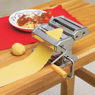 This restaurant-quality pasta maker combines Old-World tradition with modern technology. Ideal for home and professional use, it kneads dough and shapes pasta with each turn of the handle. Attachments (sold separately) include: Square Ravioli, Half-Moon Ravioli, Lasagna, Linguini, Spaghetti and Angel Hair. Also includes a clamp for countertop attachment. Stainless steel. Imported. 8-1/4L x 8W x 6-1/4H. Color: Stainless Steel. - $35.99