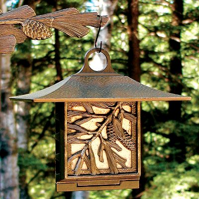 Camp and Hike Attract beautiful woodpeckers, chickadees and other birds into your yard using a bird's favorite feed. Easy-access side door opens for loading suet cakes and easy cleaning. Roof protects suet from sun and rain for long-lasting feed. Includes hanger for easy installation, or purchase the matching Pine Cone Nature Hook (sold separately) to complement the feeder. Rust-free, fade-resistant 100% recycled aluminum for outdoor use. Allow two weeks for shipping. Made in USA. Weight: 1.9 lbs. Dimensions: 10 x 9 x 6-3/4 . Colors: Bronze/Gold, Copper, Verdigris. Color: Bronze. - $36.99