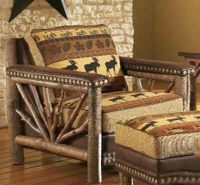Hunting Bring the look of a vacation lodge to your home with this handcrafted, log-accented chair. Handcrafted, authentic rustic poplar wood arms have a sunburst twig design. The fully upholstered seating area invites you to sit down in superb comfort. The patterned chenille fabric shows a bull moose, fish and forest leaves, all in nature-rich colors of tan, forest green, russet burgundy and black. Granite-colored, tweedlike chenille boxing fabric and chocolate brown faux leather for the body and contrast welting match nicely with the pattern. Hand-applied Cabelas nail trim is featured at the arms and base. Seat cushion is reversible to chocolate brown faux leather. Assembled with kiln-dried, fortress frame construction. Machine-tied coil seating unit and high-density, high-resiliency cushions with fiber wrapping provide level comfort across the seating area. Made in USA. 37L x 40D x 38H. Color: Forest Green. - $1,499.99